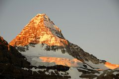 Bright Orange Light Of Sunrise On Mount Assiniboine And Glacier Below Summit From Lake Magog